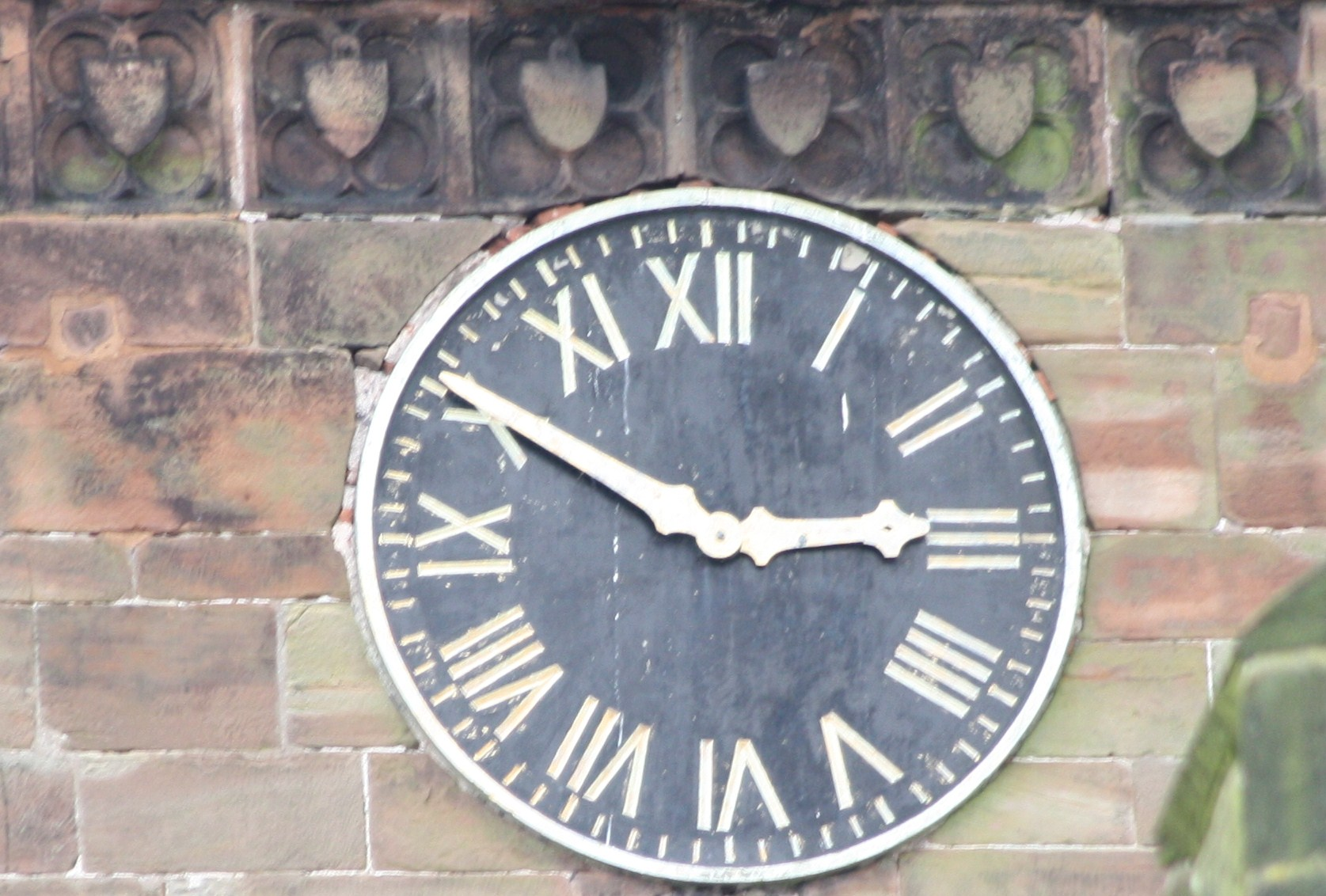 stands the church clock at ten to three